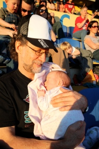 Sleeping on Grandpa at one of my first professional Ultimate games. Not so exciting for me yet...